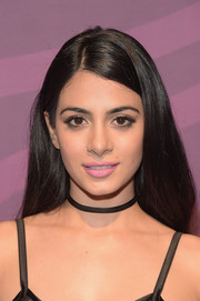 Emeraude Toubia opted for a simple loose side-parted style when she attended the ABC Freeform Upfront.