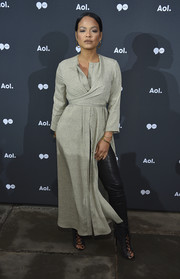 Christina Milian made a stylish appearance at the 2016 AOL NewFront wearing a gray wrap dress over black leather pants.