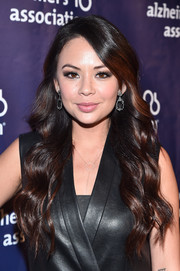 Janel Parrish was sweetly coiffed with this long wavy 'do at the Alzheimer Association's A Night at Sardi's event.