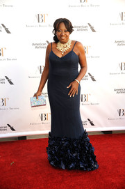 Star Jones got all dolled up in a midnight-blue spaghetti-strap gown with a ruffled hem for the American Ballet Theatre Spring Gala.