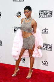 Keke Palmer topped off her attention-grabbing attire with a pink fur coat.