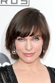 Milla Jovovich attended the 2016 AMAs wearing her signature bowl cut.