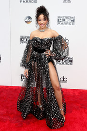 Tinashe grabbed attention in a sheer polka-dot off-the-shoulder gown by Michael Costello at the 2016 AMAs.