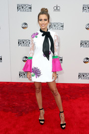 Renee Bargh oozed feminine appeal in a pussybow cocktail dress with bell sleeves and sequin detailing at the 2016 AMAs.
