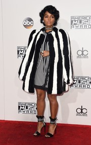 Janelle Monae brought an overload of stripes to the AMA red carpet with this black-and-white Marc Jacobs fur coat and dress combo.