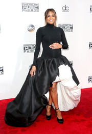 Ciara paired her dress with black satin platform pumps.