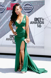Meagan Good turned up the heat at the 2016 BET Awards in an emerald-green Lorena Sarbu gown with a low neckline, waist cutouts, and a high slit.