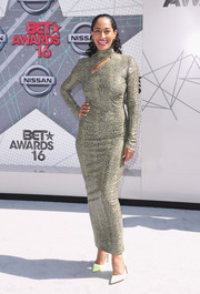 Tracee Ellis Ross teamed her dress with neon-yellow pumps by Christian Louboutin.