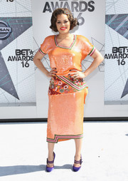 Andra Day's purple Moschino Mary Jane pumps worked beautifully with her orange dress.