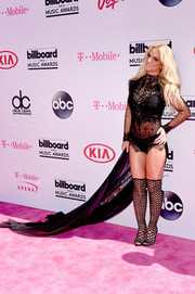 Britney Spears donned a black Reem Acra lace bodysuit with a long train for the Billboard Music Awards. It was classic Britney!