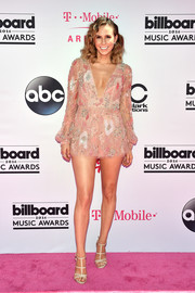 Keltie Knight went for a leggy look in a beaded pink romper with a deep-V neckline during the Billboard Music Awards.