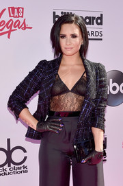 Demi Lovato arrived for the Billboard Music Awards carrying a black Chanel Lego clutch.