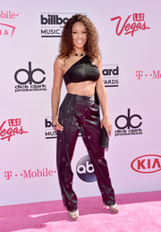 Serayah McNeill completed her outfit with black satin pants.