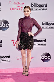 Lucy Hale worked a high-neck purple knit bodysuit by Zuhair Murad at the Billboard Music Awards.