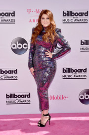 Meghan Trainor stuck to her signature sequined look with this bold-shouldered gunmetal number by Michael Costello during the Billboard Music Awards.