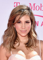 Liz Hernandez wore her hair down to her shoulders with bouncy, high-volume waves at the Billboard Music Awards.