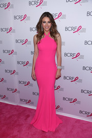 Elizabeth Hurley couldn't be missed in this figure-hugging neon halter gown by Jovani at the Hot Pink Party.