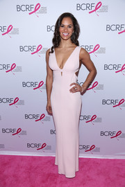 Misty Copeland chose a cleavage-flaunting cutout gown for her Hot Pink Party look.