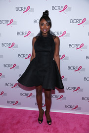 Patina Miller cut a feminine silhouette in a ruffle-collar, fit-and-flare LBD by Amaya Arzuaga at the Hot Pink Party.