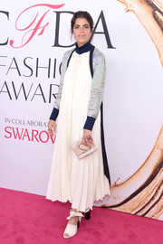 Leandra Medine layered a 3.1 Phillip Lim pleated A-line dress over a metallic sweater for her 2016 CFDA Fashion Awards look.
