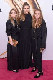 Ashley Olsen attended the 2016 CFDA Fashion Awards wearing a black maxi dress by The Row.