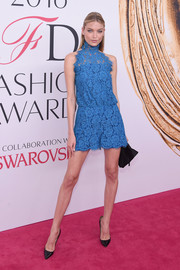 Martha Hunt was all about breezy sophistication in a high-neck blue lace romper by Diane von Furstenberg at the 2016 CFDA Fashion Awards.
