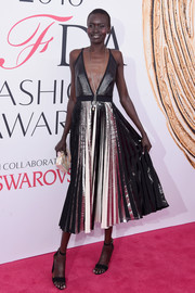 Alek Wek took a bold plunge in this monochrome cocktail dress with a navel-grazing neckline and a pleated skirt for her 2016 CFDA Fashion Awards look.