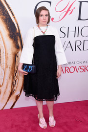 Lena Dunham completed her ensemble with a personalized chain-strap bag by Clare Vivier.
