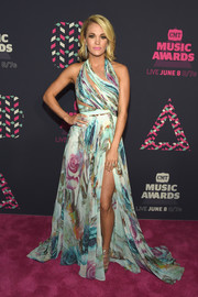 Carrie Underwood took our breath away with this colorful Mikael D floral gown, boasting a slashed bodice and a high slit, at the 2016 CMT Music Awards.
