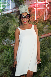 June Ambrose accessorized with a fabulous pair of butterfly sunnies at the Coach and Friends of the High Line Summer Party.