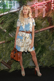 Hailey Baldwin paired her dress with chunky platform sandals by Aquazzura.