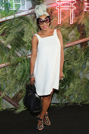 June Ambrose spruced up her simple dress with a pair of pearl-embellished T-strap sandals.