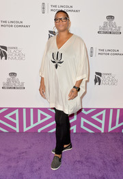 Queen Latifah kept it relaxed in black leggings when she attended the Essence Black Women in Music event.