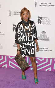 Estelle topped off her ensemble with an oversized camo-print clutch.
