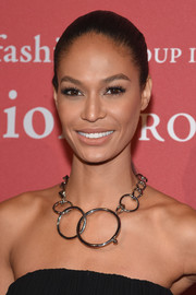 Joan Smalls decorated her bare neckline with a statement chain necklace.