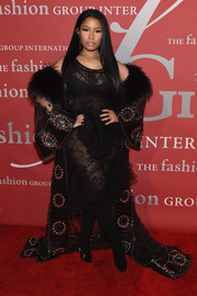 Nicki Minaj looked provocative, as always, in a sheer black lace and ruffle dress by Givenchy Couture at the 2016 Fashion Group International Night of Stars Gala.