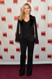 Kate Hudson channeled the '70s in a black wide-leg pantsuit by Roberto Cavalli for her Forbes Women's Summit look.