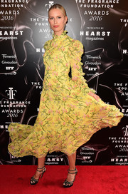 Karolina Kurkova charmed in a yellow Erdem print dress with ruffle detailing at the 2016 Fragrance Foundation Awards.