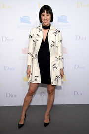 Eva Chen layered a beaded white Dior coat over a little black dress for the 2016 Guggenheim International pre-party.