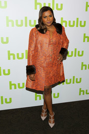 Mindy Kaling arrived for the 2016 Hulu Upfront looking posh in a fur-trimmed orange coat by her favorite designer, Salvador Perez.