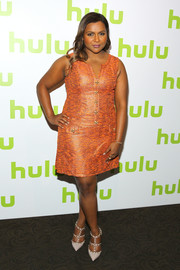 Mindy Kaling was retro-chic in an orange print dress by Salvador Perez at the 2016 Hulu Upfront.
