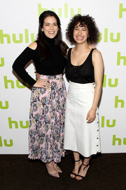 Ilana Glazer teamed her top with a white A-line denim skirt.