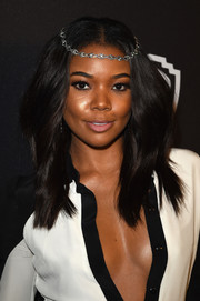 Gabrielle Union attended the InStyle and Warner Bros. Golden Globes post-party looking boho with her center-parted 'do.