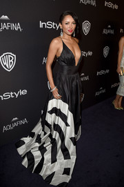Kat Graham made a sexy entrance at the InStyle and Warner Bros. Golden Globes post-party in a plunging black-and-white fishtail gown by Yanina Couture.