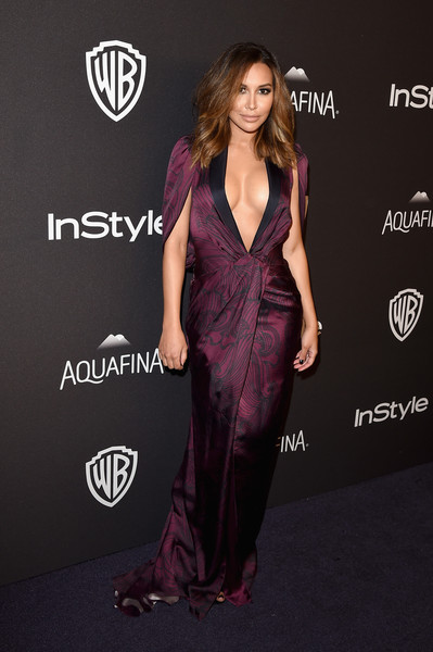 Naya Rivera put on a daring display at the InStyle and Warner Bros. Golden Globes post-party in a purple Pamela Rolland tuxedo dress with a navel-grazing plunge.