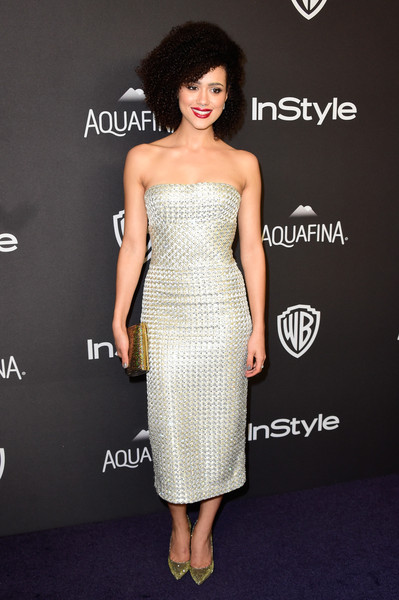 Nathalie Emmanuel finished off her high-shine look with a metallic gold clutch.