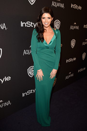Katherine Schwarzenegger slipped into an emerald-green column dress by Armani for the InStyle and Warner Bros. Golden Globes post-party.