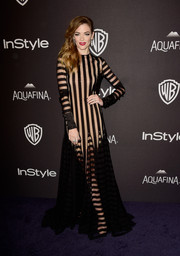 Jaime King was modern-glam at the InStyle and Warner Bros. Golden Globes post-party in a sheer black Monse gown rendered in a chic blend of vertical and horizontal stripes.