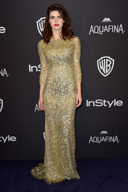 Alexandra Daddario looked fab in a chartreuse sequin gown by Reem Acra at the InStyle and Warner Bros. Golden Globes post-party.