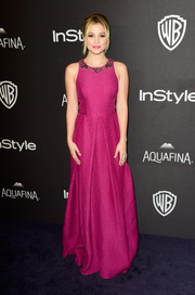 Olivia Holt kept it youthful and feminine in a fuchsia Marchesa Notte gown with an embellished neckline at the InStyle and Warner Bros. Golden Globes post-party.